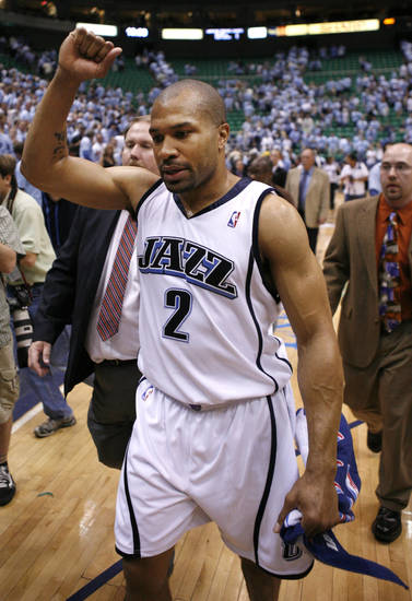 Utah Jazz's Derek Fisher walks off the court after a second-round playoff NBA basketball game against the Golden State Warriors, Wednesday, May 9, 2007, in Salt Lake City. The Jazz won 127-117 in overtime. (AP Photo/Steve C. Wilson)