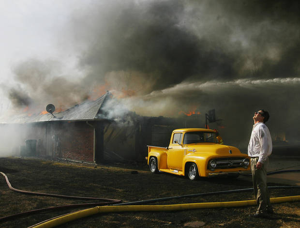 Paul Norwood watches helplessly as his neighbor's home is destroyed by wildfires in eastern Oklahoma County, Thursday, April 9, 2009.  These homes are in Oakwood East Royale Addition, near SE 15 and Westminster. Photo by Jim Beckel, The Oklahoman