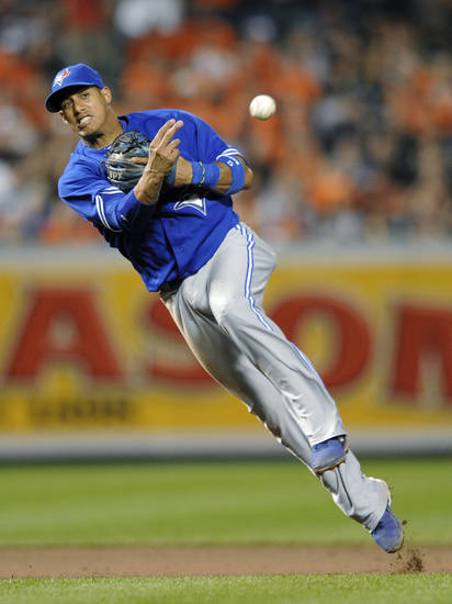 FILE - In this Sept. 26, 2012, file photo, Toronto Blue Jays shortstop Yunel Escobar throws to first for the out during the eighth inning of a baseball game against the Baltimore Orioles in Baltimore. Escobar's stay with the Miami Marlins lasted all of two weeks. The payroll-slashing Marlins dealt the shortstop and his $5 million salary across Florida to the Tampa Bay Rays on Tuesday, Dec. 4, 2012, for minor league infielder Derek Dietrich. (AP Photo/Nick Wass, File)