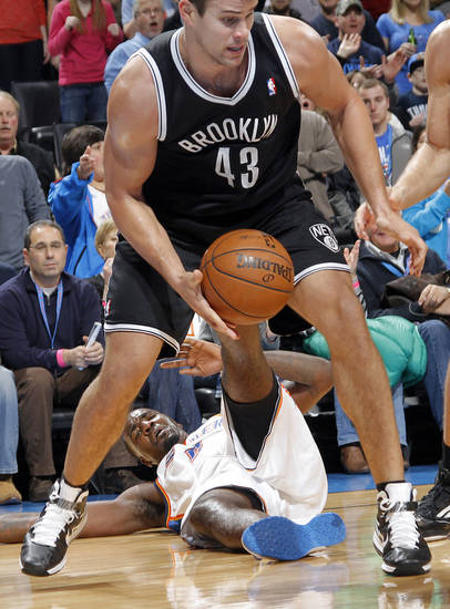 Oklahoma City's Kendrick Perkins (5) hits the courts as he looses the battle with Brooklyn Nets' Kris Humphries (43) during the NBA basketball game between the Oklahoma City Thunder and the Brooklyn Nets at the Chesapeake Energy Arena on Wednesday, Jan. 2, 2013, in Oklahoma City, Okla. Photo by Chris Landsberger, The Oklahoman