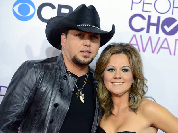 FILE - This Jan. 9, 2013 file photo shows Jason Aldean, left, and his wife Jessica at the People�s Choice Awards at the Nokia Theatre in Los Angeles. Court papers filed April 26, show Aldean has filed for divorce from his wife Jessica Ussery.  (Photo by Jordan Strauss/Invision/AP, file)