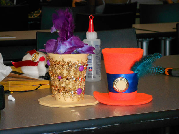 A photo from a Monthly Tea held Sept. 8 at the Downtown Library, where more than 80 people attended. These hats were made by attendees as one of the activities.  At OctopodiCon, Bev Hale will be teaching a Makeshop on how to make these tiny top hats.  Photo provided.   <strong></strong>