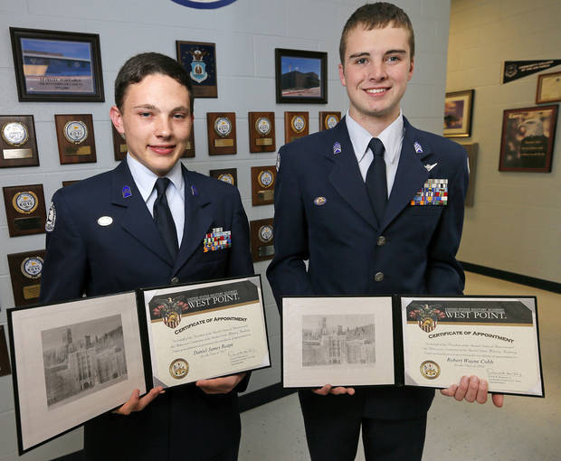 Daniel Reape, left, and Wayne Cobb, seniors in the Edmond North Air Force JROTC, show their certificates of appointment to the U.S. Military Academy at West Point. Photo by Nate Billings, The Oklahoman