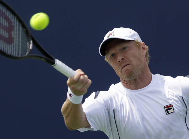 Dmitry Tursunov, from Russia, hits a forehand against David Ferrer, from Spain, during a match at the Western & Southern Open tennis tournament, Thursday, Aug. 15, 2013, in Mason, Ohio. (AP Photo/Al Behrman)