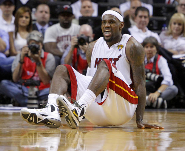 Miami's LeBron James (6) reatcs after an injury during Game 4 of the NBA Finals between the Oklahoma City Thunder and the Miami Heat at American Airlines Arena, Tuesday, June 19, 2012. Oklahoma City lost 104-98.  Photo by Bryan Terry, The Oklahoman