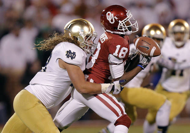 Notre Dame 's Dan Fox (48) breaks up a pass for OU's Jalen Saunders(18) that led to a Notre Dame interception during the college football game between the University of Oklahoma Sooners (OU) and the Notre Dame Fighting Irish at the Gaylord Family-Oklahoma Memorial Stadium on Saturday, Oct. 27, 2012, in Norman, Okla. Photo by Chris Landsberger, The Oklahoman