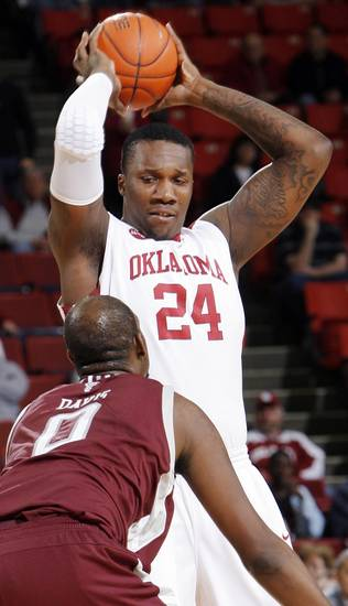 OU's Tiny Gallon (24) keeps the ball away from Bryan Davis (0) of Texas A&M in the first half during the men's college basketball game between the Oklahoma Sooners and Texas A&M Aggies at Lloyd Noble Center in Norman, Okla., Saturday, March 6, 2010. Photo by Nate Billings, The Oklahoman