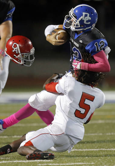 Carl Albert&#039;s Bryan Williams tackles Deer Creek&#039;s Joel Blumenthal during the high school football game between Deer Creek and Carl Albert at Deer Creek High School, Friday, Sept. 21, 2012.  Photo by Sarah Phipps, The Oklahoman