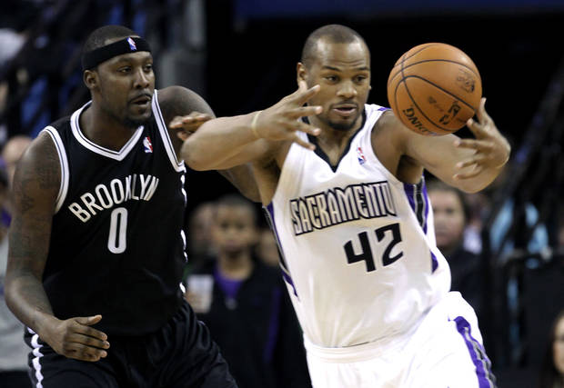 Sacramento Kings forward Chuck Hayes, right, grabs the ball against Brooklyn Nets forward Andray Blatche during the first quarter of an NBA basketball game in Sacramento, Calif., Sunday, Nov. 18, 2012. (AP Photo/Rich Pedroncelli)