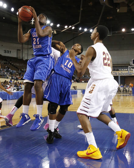 Millwood's Jamal Green-Gaskins shoots during the 3A boys semifinal game between the Millwood High School Falcons and the Centennial Bison at the State Fair Arena on Friday, March 8, 2013 in Oklahoma City, Okla.  Chris Crook of Millwook and Corneilous McKiver are at right.  Photo by Steve Sisney, The Oklahoman