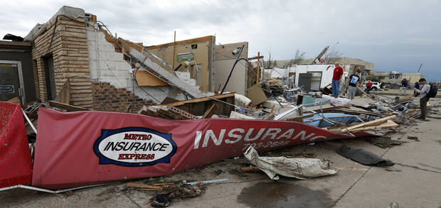 An insurance office destroyed by Monday'a tornado lies in ruins Tuesday near  Telephone Road and SW 4 in Moore.  Photo by Steve Sisney, The Oklahoman <strong>STEVE SISNEY - THE OKLAHOMAN</strong>