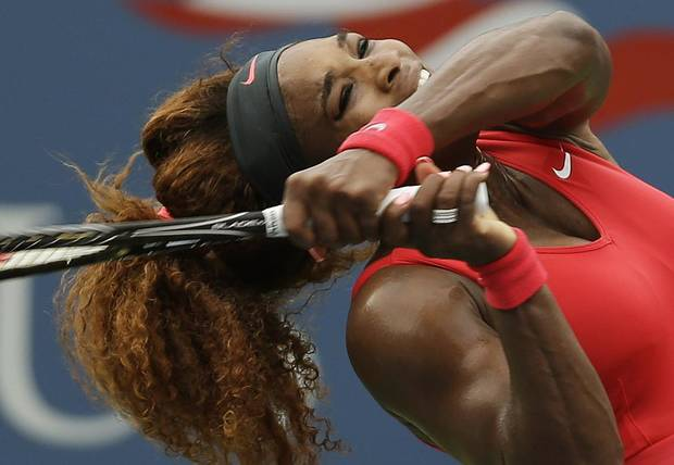 Serena Williams returns a shot to Sloane Stephens during the fourth round of the 2013 U.S. Open tennis tournament, Sunday, Sept. 1, 2013, in New York. (AP Photo/Darron Cummings)
