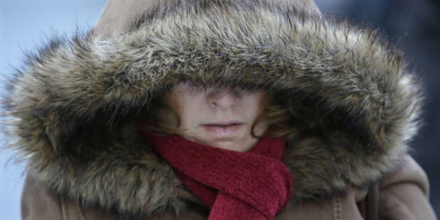A Commuter bundles up against extreme cold conditions Tuesday, Jan. 22, 2013, in Chicago. Temperatures in the area were hovering around zero with sub-zero wind chill reading hitting 10 below. Forecasters say waves of frigid Arctic air began moving over the region Saturday night Jan. 19, 2013. Temperatures are expected to rebound Wednesday Jan. 23, 2013. (AP Photo/M. Spencer Green)