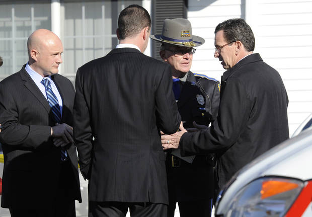 Gov. Dannel P. Malloy, right, talks with officials at a staging area following a shooting at the Sandy Hook Elementary School in Newtown, Conn., about 60 miles (96 kilometers) northeast of New York City, Friday, Dec. 14, 2012. An official with knowledge of Friday's shooting said 27 people were dead, including 18 children. (AP Photo/Jessica Hill)