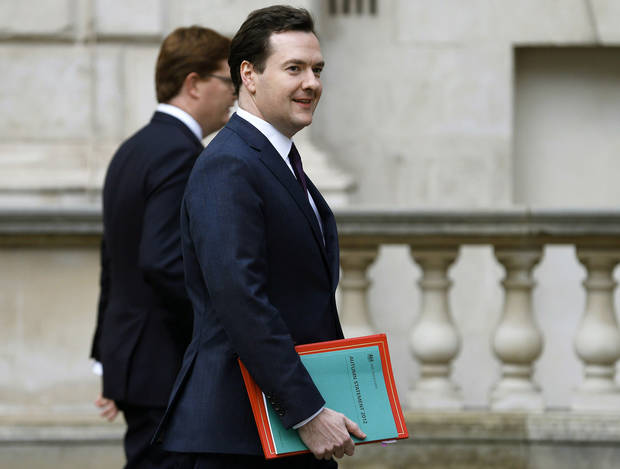 Britain's Chancellor of the Exchequer, George Osborne, right, walks with Chief Secretary to the Treasury, Danny Alexander, to deliver the half-yearly budget statement to parliament in London, Wednesday Dec. 5, 2012. Britain's Treasury chief, George Osborne, unveiled plans to kick-start the U.K.'s moribund economy when he presented his updated budget policies to lawmakers. (AP Photo/Andrew Winning, Pool)