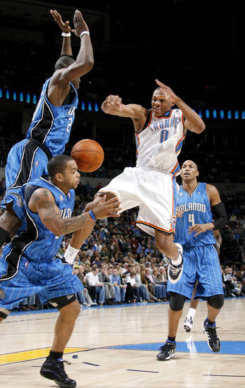 Oklahoma City&#039;s Russell Westbrook loses control of the ball between Orlando&#039;s Mickael Pietrus, left, Jameer Nelson, and Tony Battie during the NBA basketball game between the Oklahoma City Thunder and the Orlando Magic at the Ford Center in Oklahoma City, Wednesday, Nov. 12, 2008. BY BRYAN TERRY, THE OKLAHOMAN  