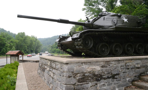 In this Thursday, June 27, photo, an old Army tank now stands as a monument near the entrance to Fort Knox, Ky. The Pentagon recently announced that the historic Army post would lose its only combat brigade, just a few years after the post's Armor school was transferred to Fort Benning, Ga. (AP Photo/Dylan Lovan)