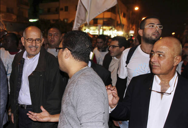 Mohammed ElBaradei, former director of the U.N. nuclear agency, leads one of many anti-Morsi protest marches heading to Tahrir square Tuesday, Nov. 27, 2012. At least a hundred thousand Egyptians have been protesting today in a central square in Cairo, challenging the decision by Egypt's president to grant himself sweeping new powers. The protesters, waving Egyptian flags and chanting slogans against President Mohammed Morsi, joined hundreds of others who had been camping out in the square since Friday, demanding that the decrees be revoked. (AP Photo/Ahmed Ramadan)