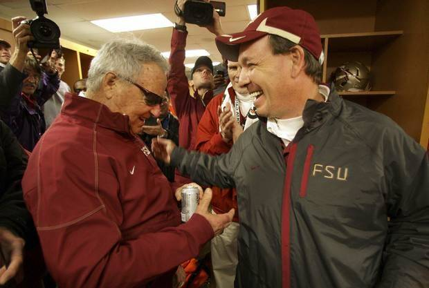 Bobby Bowden (left) and Jimbo Fisher chat in the locker room after Florida State's Gator Bowl victory in January 2010, Bowden's last game as head coach. (AP Photo)