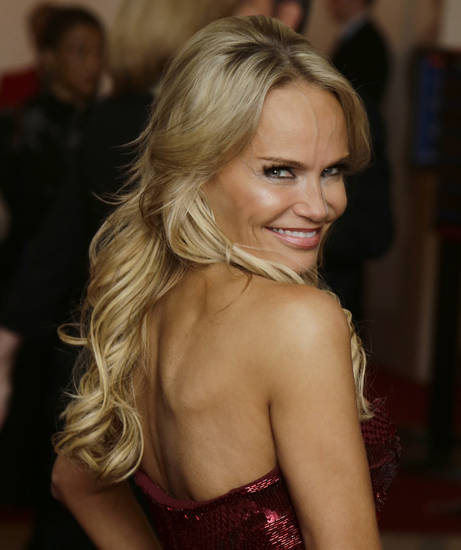 Actress Kristin Chenoweth poses for photographers on the red carpet before entertainer Ellen DeGeneres receives the 15th annual Mark Twain Prize for American Humor at the Kennedy Center, Monday, Oct. 22, 2012, in Washington. (AP Photo/Alex Brandon) ORG XMIT: DCAB108