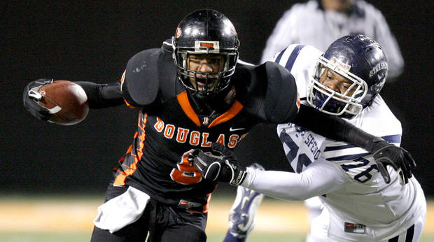 Marcus Caddell of Douglass runs past Joseph Christian of Star Spencer during the Class 4A high school football state championship game betweeen Star Spencer Douglass at Boone Pickens Stadium in Stillwater, Okla., Saturday, December 5, 2009. Photo by Bryan Terry, The Oklahoman