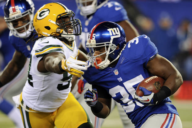 New York Giants' Andre Brown (35) rushes past Green Bay Packers' Dezman Moses (54) during the first half of an NFL football game, Sunday, Nov. 25, 2012, in East Rutherford, N.J. (AP Photo/Bill Kostroun)