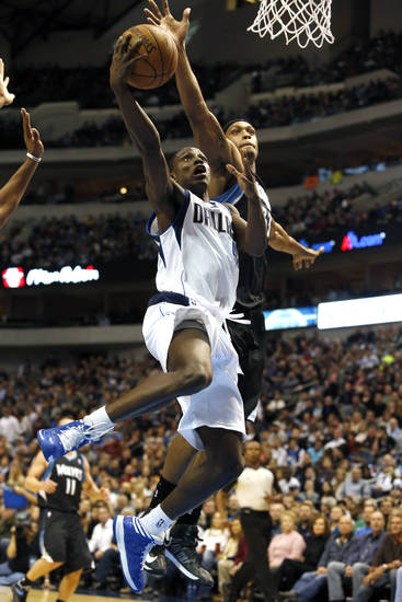 Dallas Mavericks guard Darren Collison (4) shoots as Minnesota Timberwolves forward Dante Cunningham (33) defends during the first half of an NBA basketball game, Monday, Jan. 14, 2013, in Dallas. (AP Photo/Sharon Ellman)