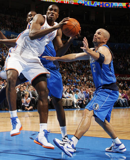 Oklahoma City's Serge Ibaka (9) tries to get the ball past Dallas' Jason Kidd (2) during the NBA basketball game between the Oklahoma City Thunder and the Dallas Mavericks at Chesapeake Energy Arena in Oklahoma City, Monday, March 5, 2012. Photo by Nate Billings, The Oklahoman