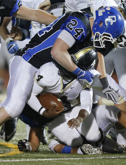 Deer Creek's Kooper Ruminer brings down McAlester's Jarome Smith during a high school football playoff game at Deer Creek, Friday, Nov. 16, 2012. Photo by Bryan Terry, The Oklahoman