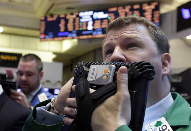 Trader Kevin Coulter, right, works on the floor of the New York Stock Exchange Tuesday, Feb. 26, 2013.  Strong earnings reports from Home Depot and Macy's helped lift stock indexes in early trading on Wall Street Tuesday. A jump in home sales and consumer confidence also brought buyers back to the market. (AP Photo/Richard Drew)