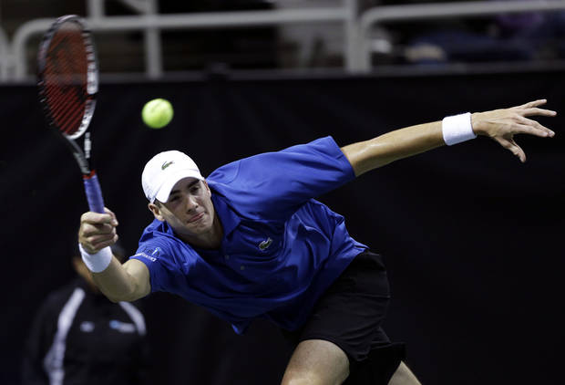 John Isner returns to Xavier Malisse, of Belgium, during the quarterfinals of the SAP Open tennis tournament in San Jose, Calif., Friday, Feb. 15, 2013. Isner won the match 7-6 (8), 6-2. (AP Photo/Marcio Jose Sanchez)