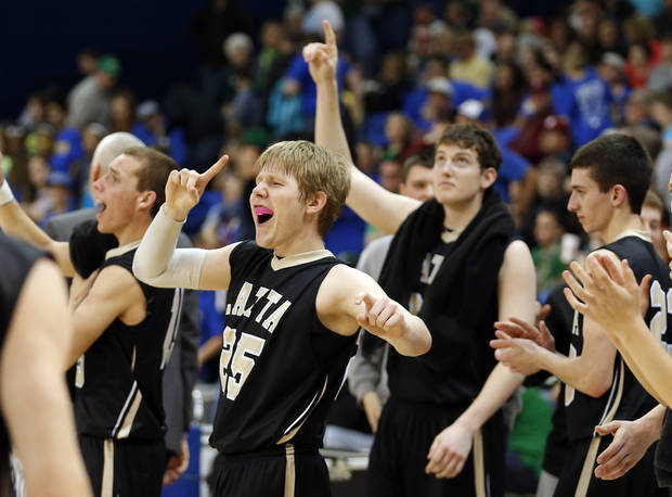 Latta's Trent Storts celebrates the Panthers' win following the 2A boys high school basketball game in the semifinals of the state tournament between Latta and Chouteau at Oklahoma City University in Oklahoma City, Friday, March 8, 2013. Photo by Sarah Phipps, The Oklahoman