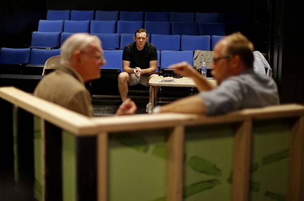 "Director Rob Gallavan, center watches Bob McGill, left, and Craig Pruitt rehearse for ""Glengarry Glen Ross"" at CitySpace Theatre on Thursday, July 24, 2014. Photo by Bryan Terry, The Oklahoman"