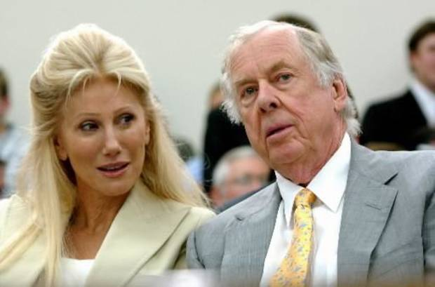 In this July 25, 2006 file photo, T. Boone  Pickens, right, with his wife,  Madeleine, appear at a House Energy and Commerce subcommittee hearing on Capitol Hill in Washington on legislation to outlaw slaughtering horses for human consumption. (AP Photo/Dennis Cook, File)
