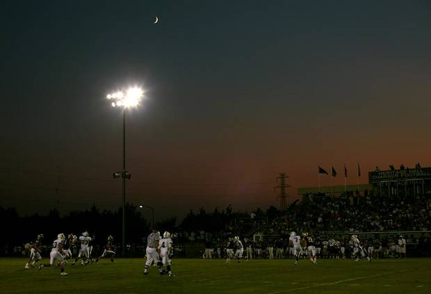 Casady and Heritage Hall play as the sun sets behind the stadium during their high school football game at Heritage Hall in Oklahoma City on Thursday, September 1, 2011. Photo by John Clanton, The Oklahoman ORG XMIT: KOD