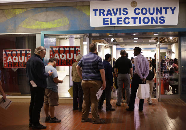 Voters wait in line at a polling place located inside a shopping mall, Tuesday, Nov. 6, 2012, in Austin, Texas. (AP Photo/Eric Gay)