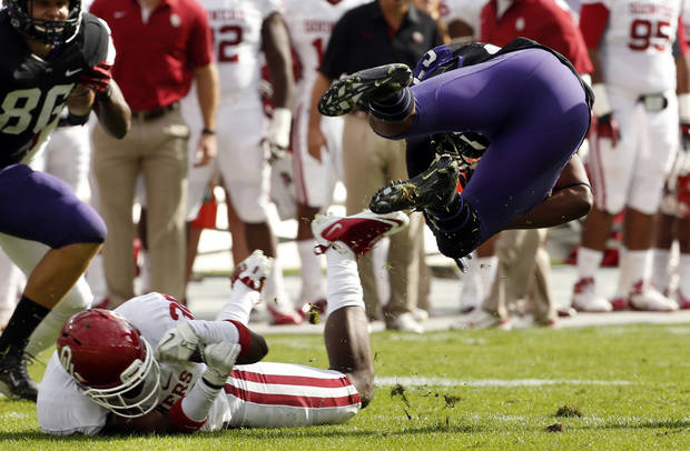Oklahoma&#039;s Javon Harris (30) upends TCU&#039;s B.J. Catalon (23) during the college football game between the University of Oklahoma Sooners (OU) and the Texas Christian University Horned Frogs (TCU) at Amon G. Carter Stadium in Fort Worth, Texas, on Saturday, Dec. 1, 2012. Photo by Steve Sisney, The Oklahoman