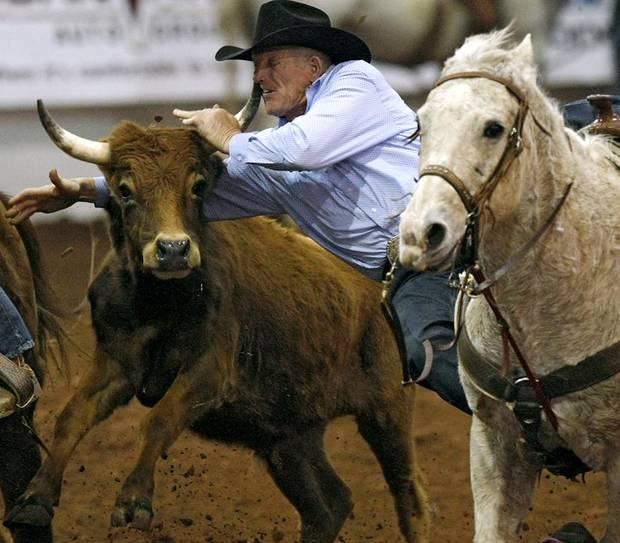 Jimmie Cooper, of Monument, New Mexico, gets a horn to his face as he competes in the steer wrestling event during Timed Event Championship at Lazy E Arena in Guthrie, Okla., on Sunday, March. 6, 2011. Photo by John Clanton, The Oklahoman ORG XMIT: KOD