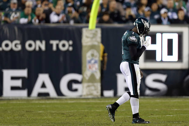 Philadelphia Eagles quarterback Michael Vick walks towards the sidelines in the first half of an NFL football game against the Dallas Cowboys, Sunday, Nov. 11, 2012, in Philadelphia. (AP Photo/Julio Cortez)