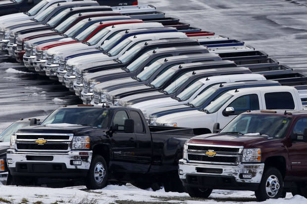 Chevy trucks line the lot of a dealer in Murrysville, Pa.  AP Photo