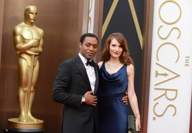 Chiwetel Ejiofor, left, and Sari Mercer arrive at the Oscars. (AP)
