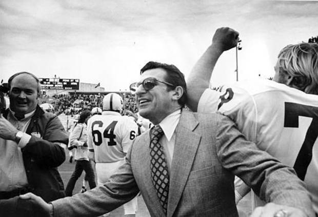 Penn State University football coach Joe Paterno celebrates after his Nittany Lions defeated the Baylor Bears in the Cotton Bowl in Dallas, Texas, Jan. 1, 1975.  Penn State won the game, 41-20.  (AP Photo)