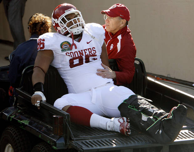Oklahoma's Adrian Taylor (86) reacts as he is carted off the field after being injured during the first half of the Brut Sun Bowl college football game between the University of Oklahoma Sooners (OU) and the Stanford University Cardinal on Thursday, Dec. 31, 2009, in El Paso, Tex.   Photo by Chris Landsberger, The Oklahoman