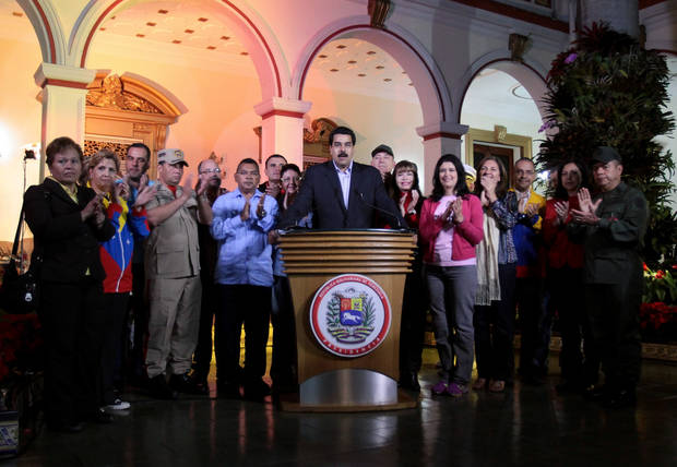 "In this photo released by Miraflores Press Office, Venezuela's Vice-President Nicolas Maduro, center, accompanied by other members of the cabinet, delivers a speech at the presidential palace in Caracas, Venezuela, Tuesday, Dec. 11, 2012. Maduro said on Venezuelan television Chavez was recovering in Cuba after an operation targeting an aggressive cancer that has defied multiple treatments. The operation was ""complex"" but was completed ""correctly and successfully,"" he said. (AP Photo/Miraflores Press Office, Francisco Batista)"