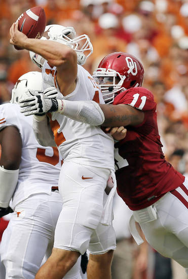 OU's R.J. Washington (11) pressures UT quarterback David Ash (14) in the first quarter during the Red River Rivalry college football game between the University of Oklahoma (OU) and the University of Texas (UT) at the Cotton Bowl in Dallas, Saturday, Oct. 13, 2012. OU won, 63-21. Photo by Nate Billings, The Oklahoman