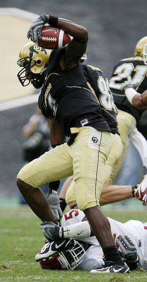 Patrick Williams of Colorado steps over Nic Harris of OU during the second half of the college football game between the University of Oklahoma Sooners (OU) and the University of Colorado Buffaloes (CU) at Folsom Field on Saturday, Sept. 28, 2007, in Boulder, Co.  By Bryan Terry, The Oklahoman