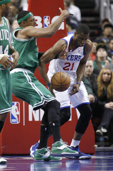 Boston Celtics' Paul Pierce (34) and Philadelphia 76ers' Thaddeus Young (21) fight for a loose ball in the first half of an NBA basketball game, Tuesday, March 5, 2013, in Philadelphia. (AP Photo/H. Rumph Jr)