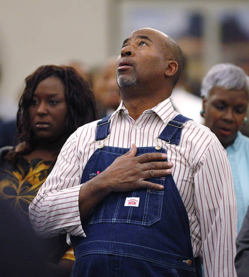 "A man stands and covers his heart during the singing of the national anthem at the 16th annual Midwest City Dr. Martin Luther King, Jr. Prayer Breakfast inside the Reed Conference Center Monday morning, Jan. 21, 2013. The theme of this year's event is ""The Wisdom of Peace."" About 400 people attended.   Photo by Jim Beckel, The Oklahoman"