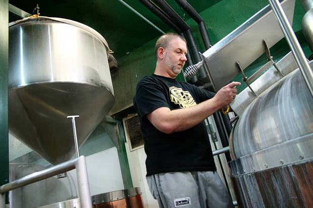 Choc Beer Co. Brewmaster Michael Lalli checks on a boiling batch of Gratzer beer. PHOTO BY NICK TROUGAKOS, THE OKLAHOMAN <strong>unknown</strong>