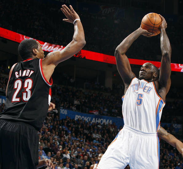 Oklahoma City's Kendrick Perkins (5) shoots the ball as Marcus Camby (23) defends for Portland in the first half during the NBA basketball game between the Oklahoma City Thunder and Portland Trail Blazers at Chesapeake Energy Arena in Oklahoma City, Tuesday, Jan. 3, 2012. Photo by Nate Billings, The Oklahoman